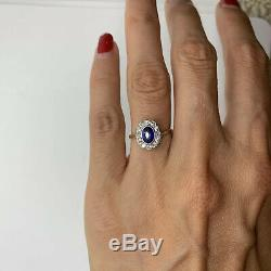 Antique Edwardian platinum 18k yellow gold oval blue sapphire diamond halo ring