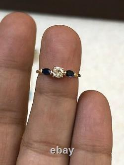 Estate 14k Yellow Gold Natural Round 0.25CT Diamond And Blue Marquise Sapphire